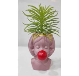 Plante artificielle fille en rose
